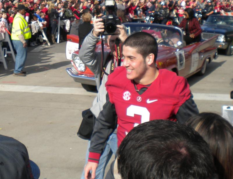Alabama Safety Vinnie Sunseri marches along University Boulevard during Saturday's parade to celebrate the 42-14 victory over Notre Dame to win the BCS title.