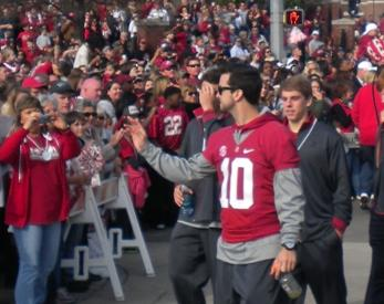 Alabama Quarterback A.J. McCarron and his team mates wave to fans of the Crimson Tide during Saturday's parade to celebrate the 42-14 victory over Notre Dame to win the BCS title.