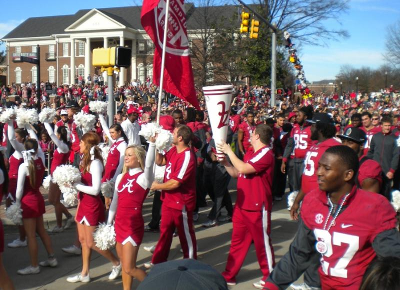 Members of the Alabama cheerleading squad take part in  during Saturday's parade to celebrate the 42-14 victory over Notre Dame to win the BCS title.