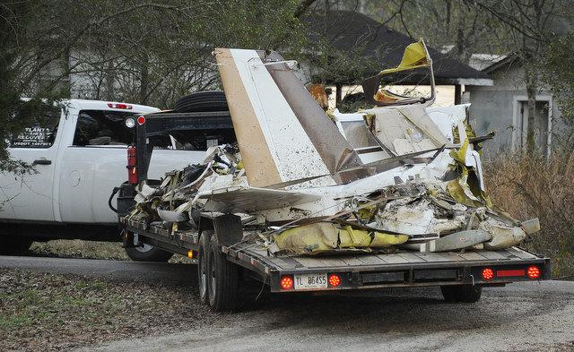 Federal authorities removing wreckage of the plane involved in the crash.