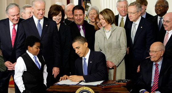 President Barack Obama signs the Affordable Care Act.