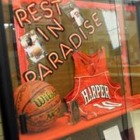 Basketball jersey and football behind glass case