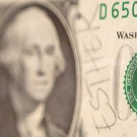 """dollar bill with """"Esther"""" written on side"""