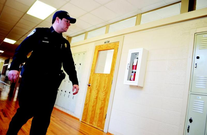 Cullman Police resource officer Bill Pagan keeps an eye on Cullman Middle School Friday afternoon. Police have been stationed at every city school in the aftermath of a school shooting in Connecticut.