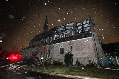The roof of the sanctuary of Trinity Episcopal Church on Dauphin Street in Mobile, Ala. was ripped off by a tornado that struck midtown Mobile Christmas Day, Tuesday, Dec. 25, 2012 in Mobile, Ala.
