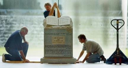 A crew prepares the Ten Commandments monument for movement from the rotunda of the Alabama Judicial Building in Montgomery, Ala., Wednesday, Aug. 27, 2003. Roy Moore fought attempts to remove the Ten Commandments monument from the Alabama Judicial Bu
