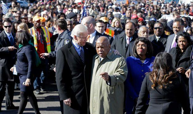 Vice President Joe Biden (left) and U.S. Congressman John Lewis (right) prepare to lead a group across the Edmund Pettus Bridge March 3, 2013.