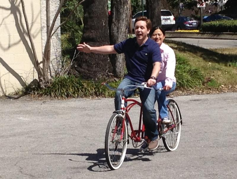 "Josh Snead and Nancy Tran on a ""bicycle built for two"""