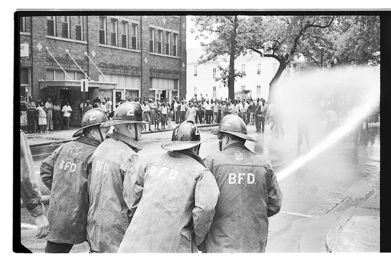 The Birmingham Fire Department point a hose at demonstrators.