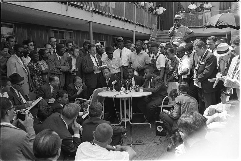 Martin Luther King, Jr and Fred Shuttlesworth hold court with the media.