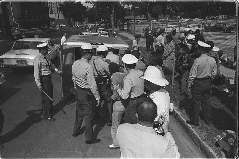 Police load young demonstrators into a paddywagon.