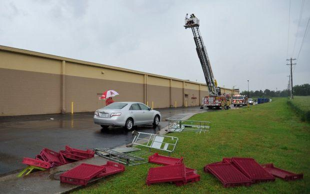 Athens fire Department checks roof damage from storm Friday afternoon at the Athens Walmart.