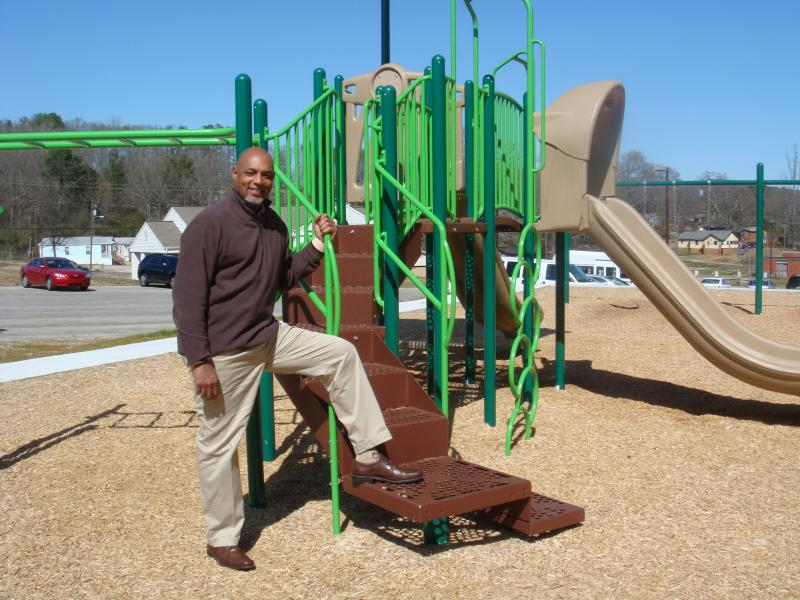 Bernard Snow stands next to a new $50,000 playground for Hobson City. He serves as Vice President of the Hobson City Community & Economic Development Corporation.