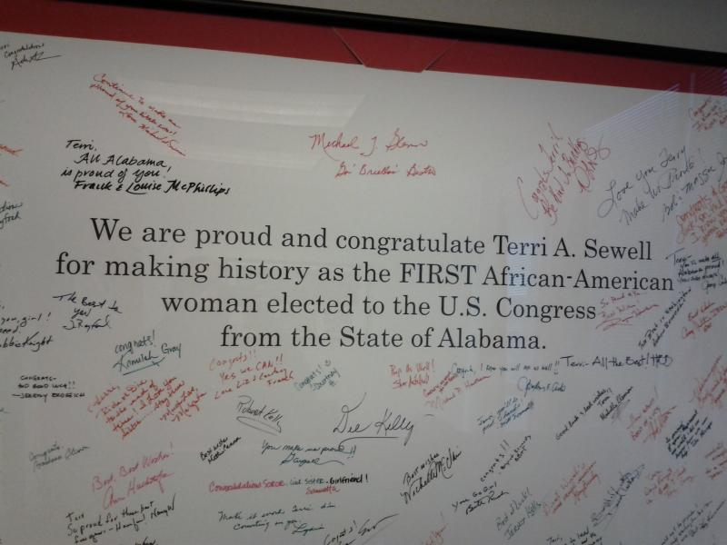 This framed banner hangs in Representative Terri Sewell's Birmigham office.