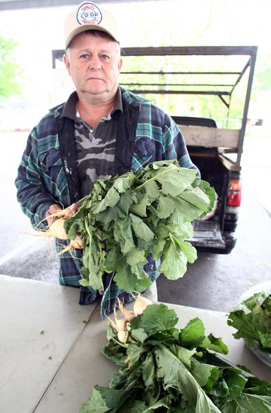Tony Traffanstedt shows off some of his farm's produce at the Calhoun County farmer's market.