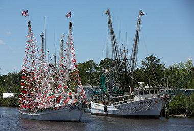 Fishing vessels are decorated for the 64th annual Blessing of the Fleet Sunday, May 5, 2013, in Bayou La Batre, Ala.