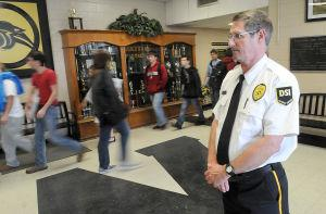Houston County school officials hired the security guards in the wake of the Newtown, Connecticut shootings.