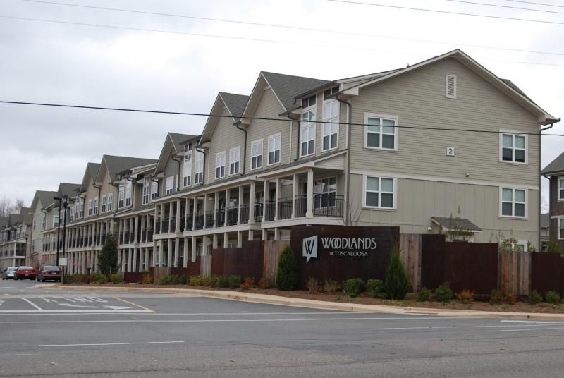 The entrance to the Woodlands of Tuscaloosa, an apartment complex that is home to many UA students. A task force will study student rental housing in the city of Tuscaloosa.