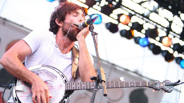 The lead singer for the Avett Brothers band, performing on stage