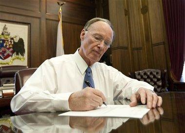 Governor Robert Bentley is out as a defendent in a lawsuit challening Alabama's abortion law.