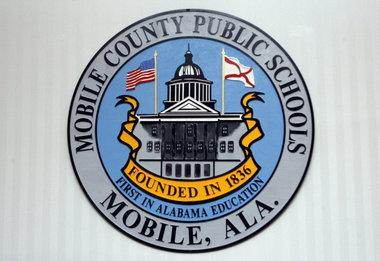 The Mobile County school system is agreeing to not suspend students for minor infractions such as not tucking a shirt or being late to class.