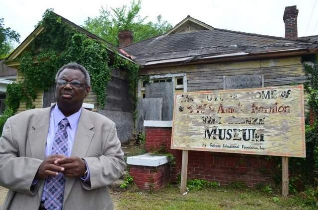 State Sen. Hank Sanders, D-Selma, stands outside a house that served as headquarters for the voting rights movement that changed American history in 1965. Sanders is trying to save the crumbling house.