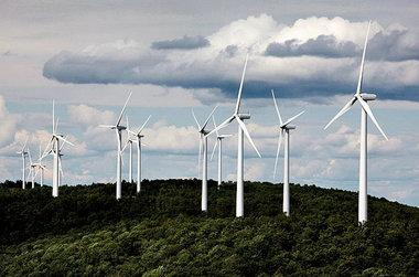 A cluster of windmills catch the wind blowing on Stetson Mountain in Maine in this photo from July 14, 2009.