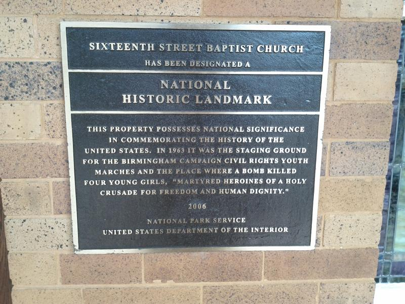 A plaque outside of the 16th Street Baptist Church in Birmingham showing it was named a National Historic Landmark.