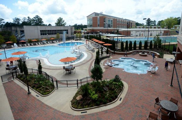 Auburn University's new recreation center includes an outdoor pool and a 45-person hot tub shaped like a tiger paw.