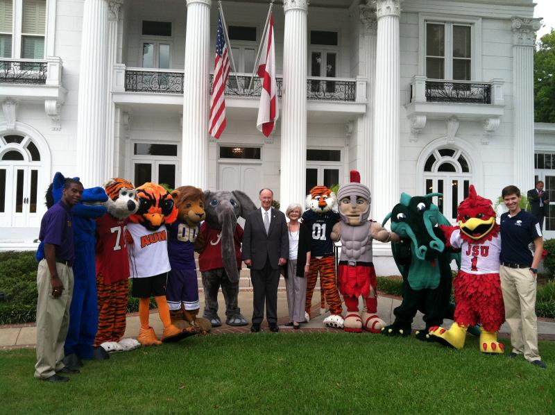 Governor Robert Bentley and First Lady Dianne Bentley standing with mascots from Alabama public universities to promote College Colors Day in 2012.