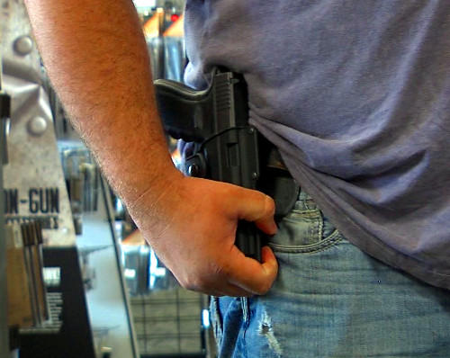 University of Alabama officials are evaluating how Alabama's new gun law will apply to campus.