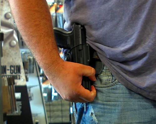 University of Alabama officials say they'll continue their ban on firearms on campus.