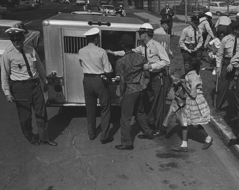 "1963 ""children's march"" protesters are rounded up by Birmingham police"