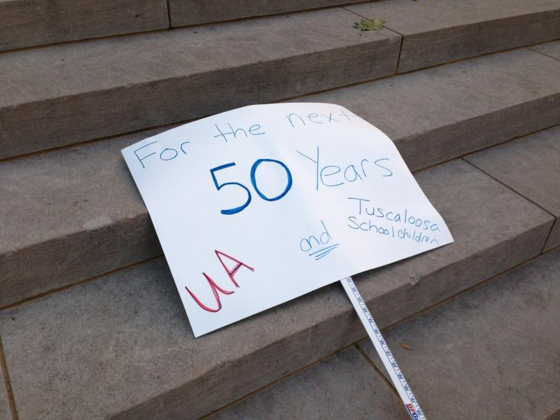 Rally sign on the steps of Gorgas Library, prior to the start of the rally
