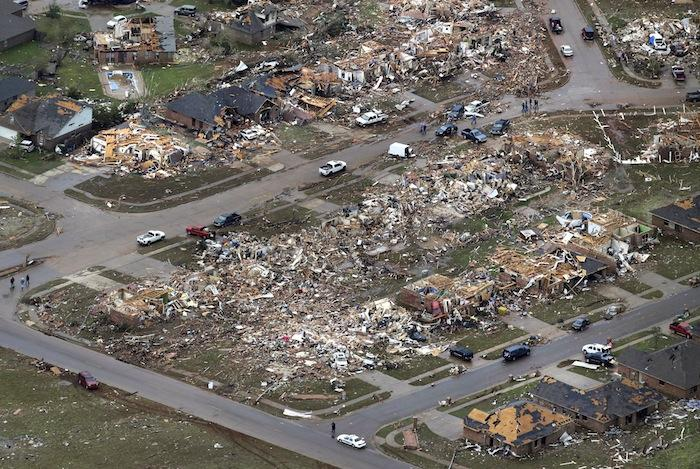 This Tuesday, May 21, 2013 aerial photo shows a neighborhood damaged by a tornado in Moore, Oklahoma.  (AP Photo/Tony Gutierrez)