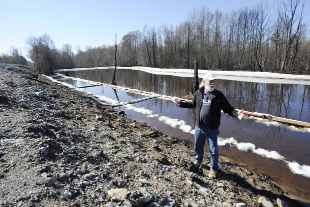 John Wathen, an environmentalist with the Waterkeeper Alliance, gestures at the site of a train derailment and oil spill near Aliceville, Ala., on Wednesday, March 5, 2014. (AP Photo/Jay Reeves)