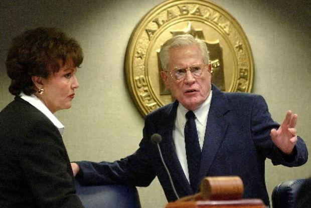 Lt. Gov. Lucy Baxley and Secretary of the Senate McDowell Lee talk before the start of the 2003 legislative session. (Mickey Welsh/Montgomery Advertiser)