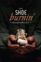 Book cover - close up of man in green shirt holding old, stained baby shoe