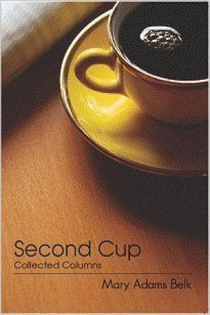 Book cover with yellow coffee cup and saucer, filled with coffee, on a brown wooden table