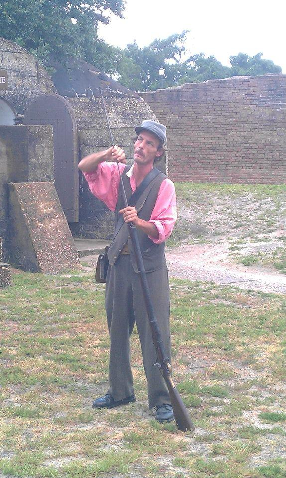 Tour guide Fort Gaines doing a weapons demonstration
