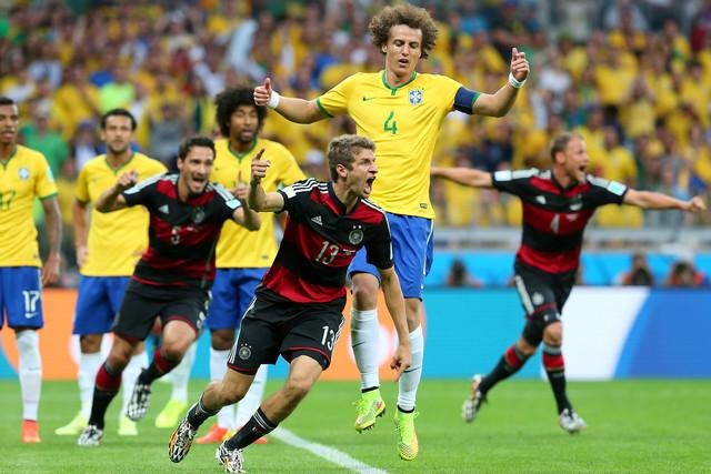 Thomas Mueller of Germany celebrates scoring his team's first goal during the 2014 FIFA World Cup Brazil Semi Final match between Brazil and Germany. Photographer: Alex Livesey/FIFA via Getty Images