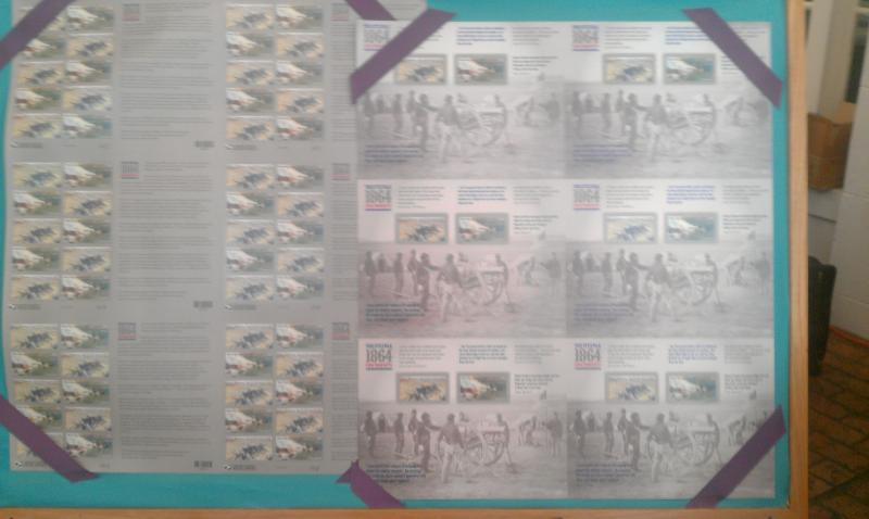 Sheets of the new stamp at the unveiling ceremony