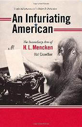 Sepia colored photograph of an orangutan sitting in front of an old-fashioned black typewriter