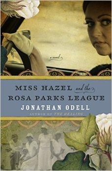 Top half of book features a 1960's styled woman in gloves sitting behind a car's steering wheel.  The bottom half features an old black and white photo of women dressed in white and a magnolia leaf off to the right side
