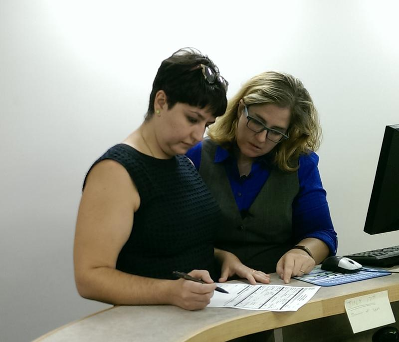 Hali Felt (L) and Jennifer Kenney (R) fill out an application for marriage license at the Tuscaloosa County Courthouse. (Photo by Alex AuBuchon)