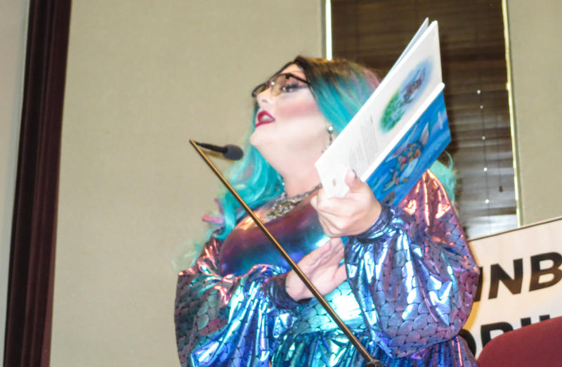 "Wade Brasfield, AKA Khloe Kash, reads during Mobile Public Library's first ""Drag Queen Story Hour."""