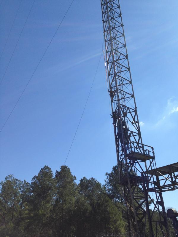 Photo of WAPR tower with repair crews climbing the tower