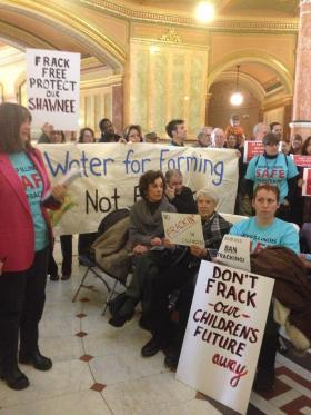 Environmentalists who oppose any form of high-volume hydraulic fracturing in Illinois protest at the Capitol in March.