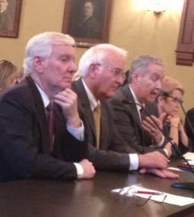 U. of I. President Robert Easter, second from left, testifies at the Statehouse in May.