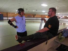Michael D'Amaro (L) & Paul Elders chat during a roller derby practice